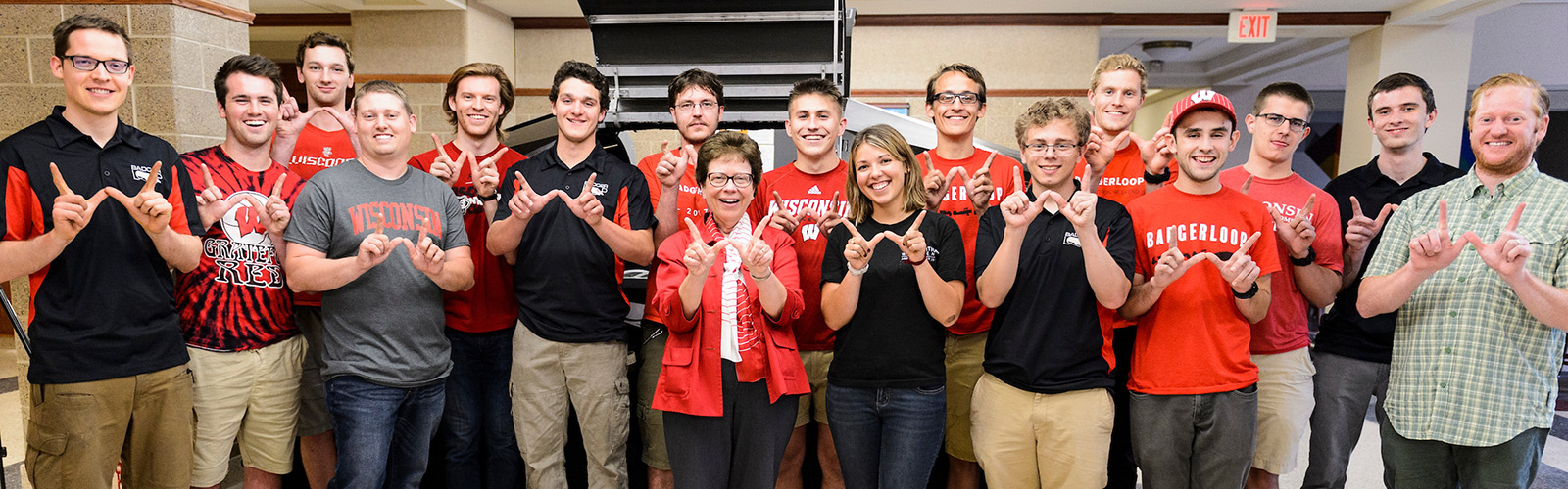 Standing near a 2016-era Badgerloop Pod, Chancellor Rebecca Blank visits with members of the College of Engineering's Badgerloop team at the Mechanical Engineering Building.