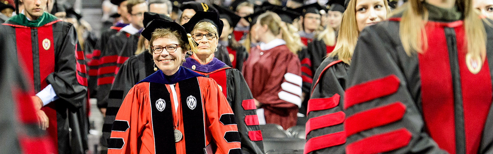 Chancellor Rebecca Blank makes her way to the stage during spring commencement ceremony at the Kohl Center.