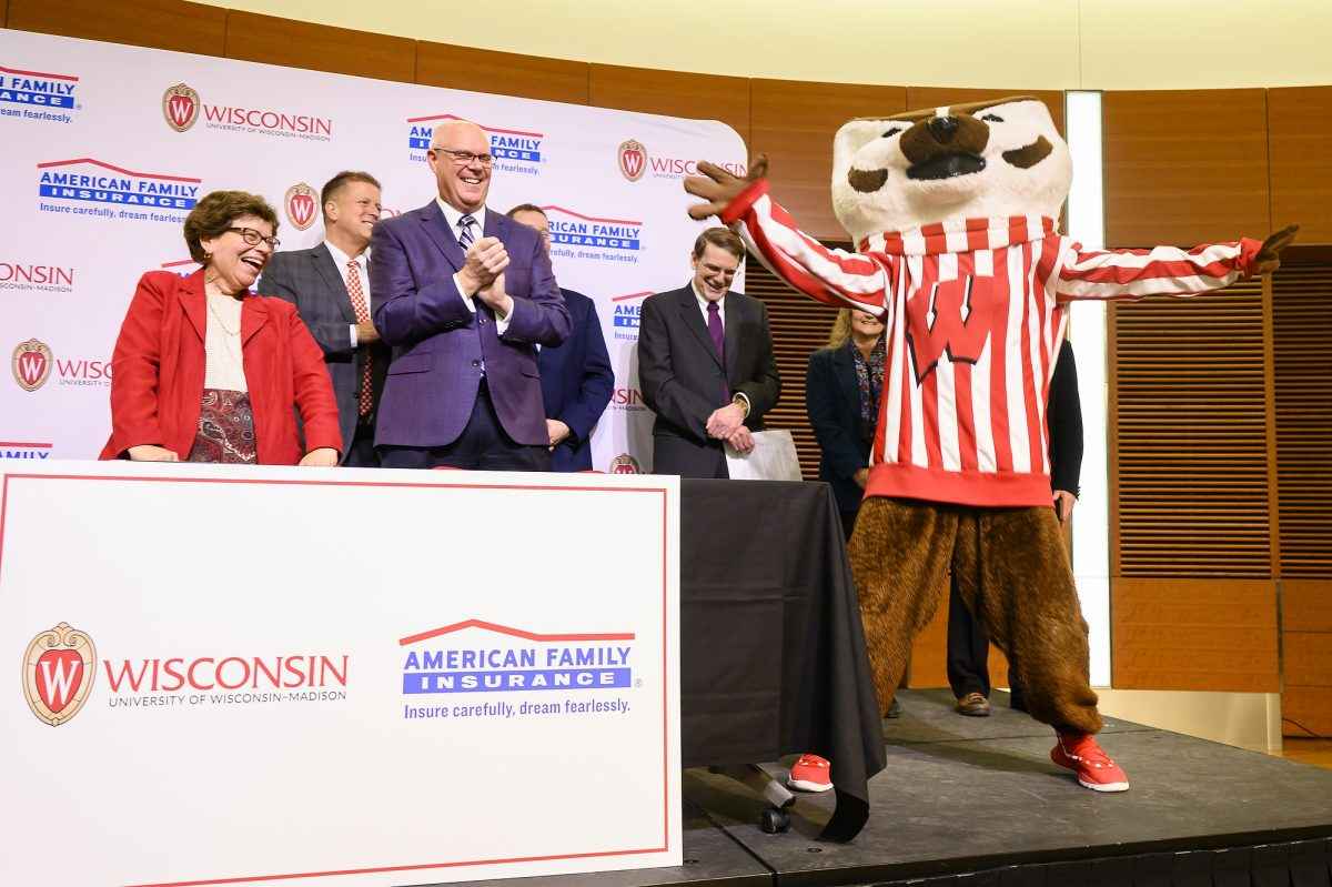 UW Chancellor Rebecca Blank and Jack Salzwedel, Chairman and CEO of American Family Insurance, are joined by UW mascot Bucky Badger after they sign a letter of intent during the University of Wisconsin-Madison and American Family Insurance Partnership Celebration Event held in the Discovery Building of the University of Wisconsin-Madison on April 19, 2019. During the event, American Family Insurance announced that it was significantly expanding its support of the university by establishing a new American Family Insurance Data Science Institute. (Photo by Bryce Richter / University of Wisconsin-Madison)