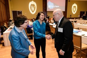 Chancellor Blank and UW System President Ray Cross greet student Isabel Markowski